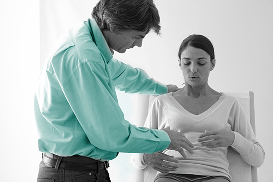 Doctor with patient consulting on stomach pain