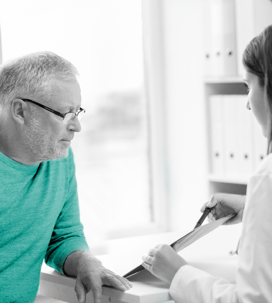 middle aged man reviewing test results with doctor