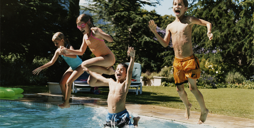 group of kids jumping into pool