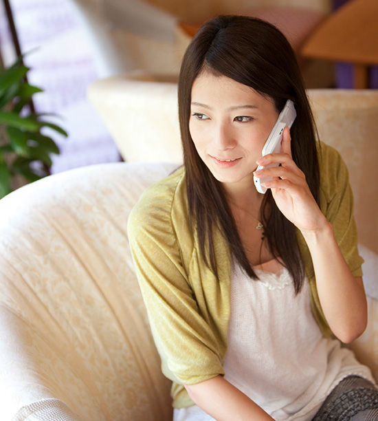 young female talking on the phone