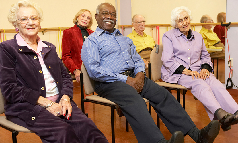 Senior Adults stretching in group class