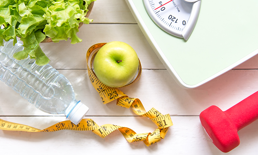 Weight managament tools (scale, tape measure, weights, healthy food)