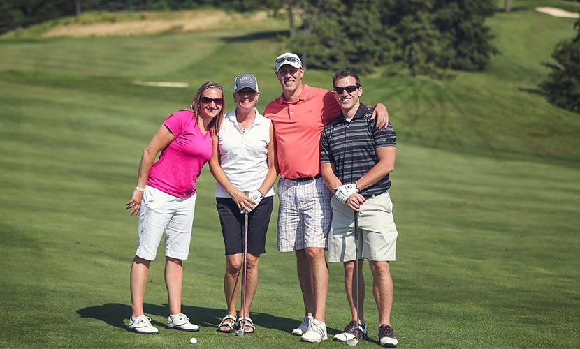 Three North Memorial Health team members at the annual golf tournament