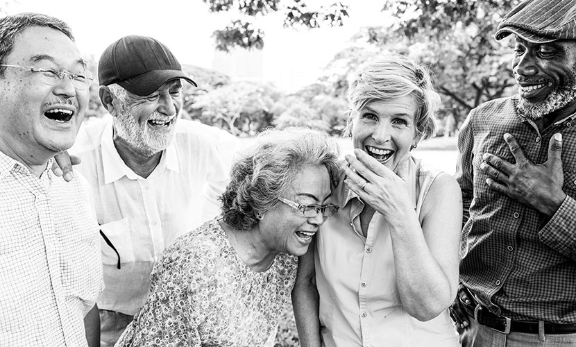 group of aging adults laughing