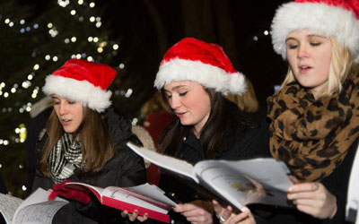 3 women singing for holidays