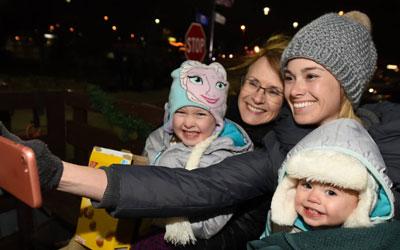 women and kids taking selfie