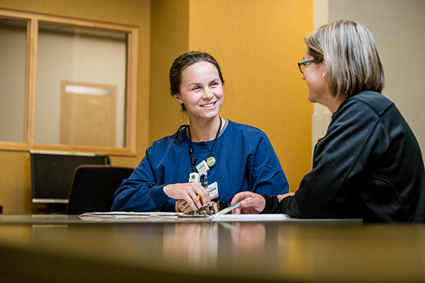 Maple Grove Hospital team members working together at desk