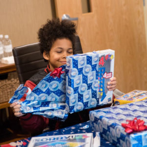 kid opening gifts