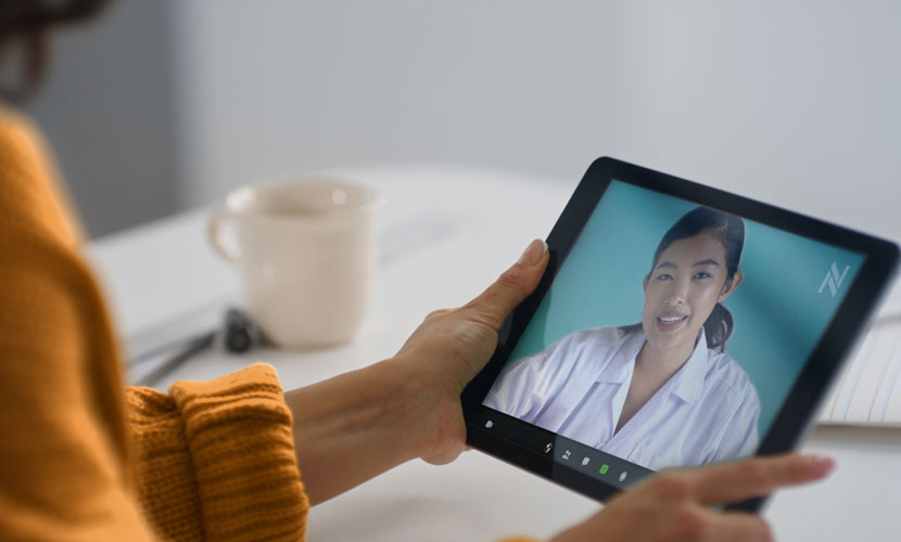 woman holding tablet for virtual doctor visit
