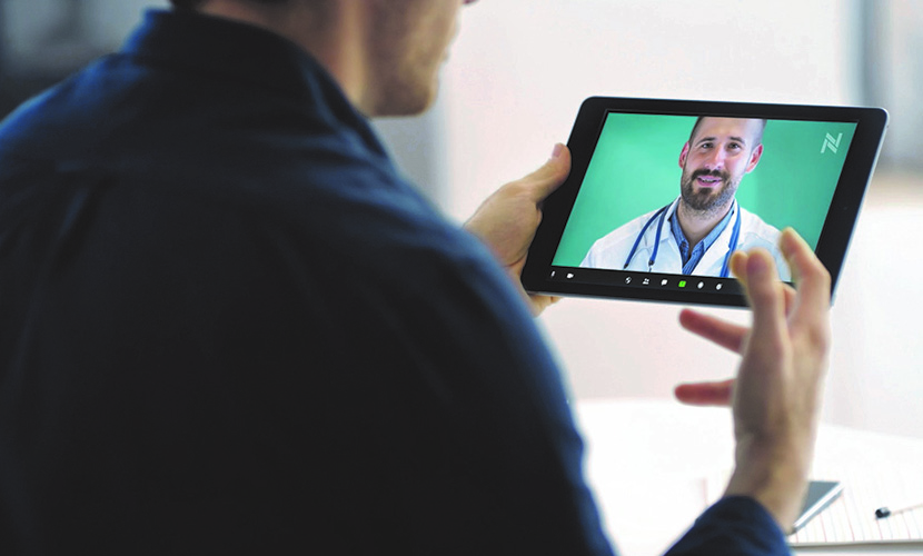 man looking at doctor on tablet